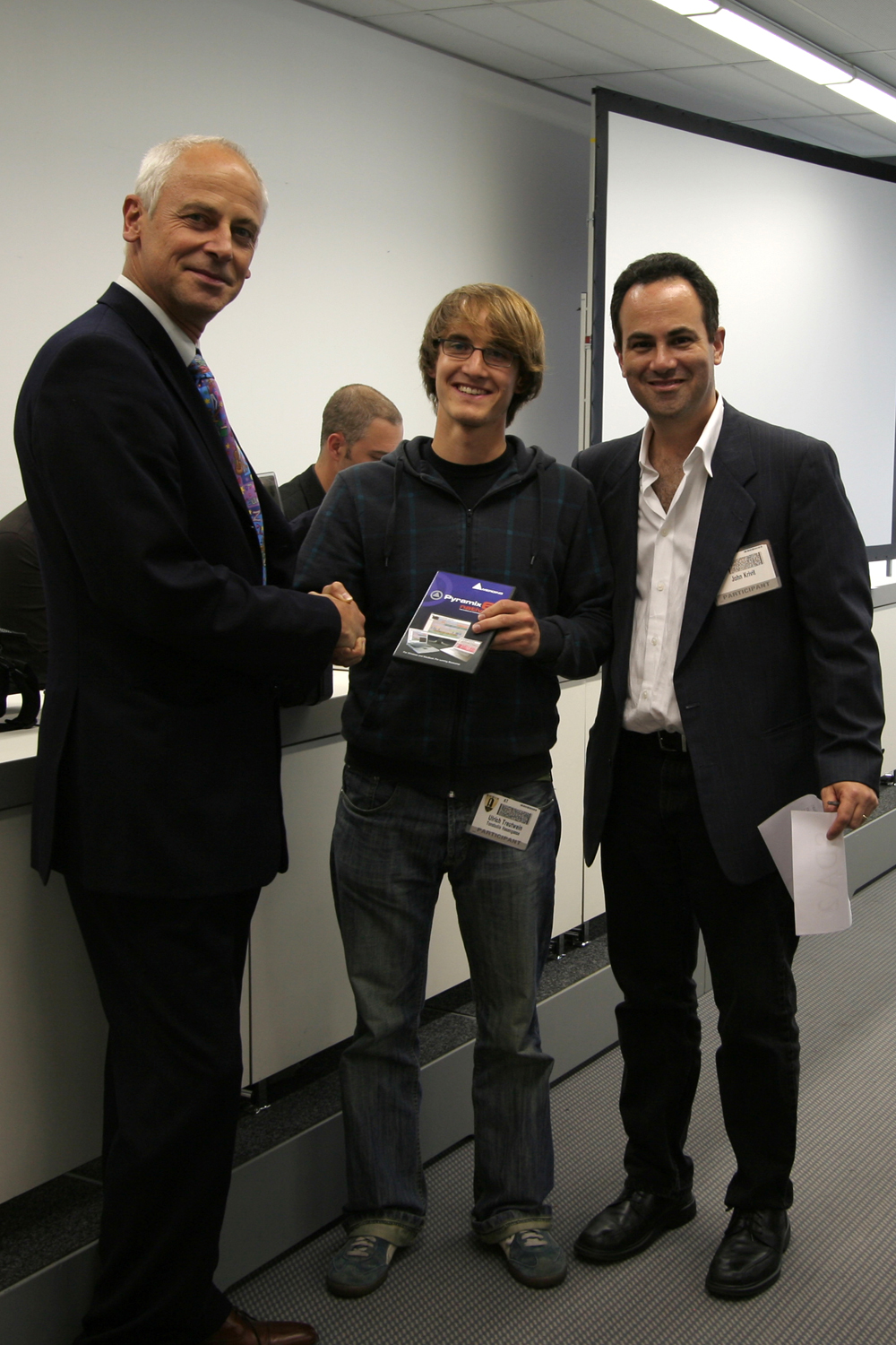 Ulrich Treutwein (centre) receives his copy of the Pyramix Native Mastering Pack from Merging Technologies President Claude Cellier (left) and John Krivit of the AES (right).